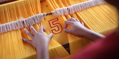 Loom with yellow fabric and embroidered 5