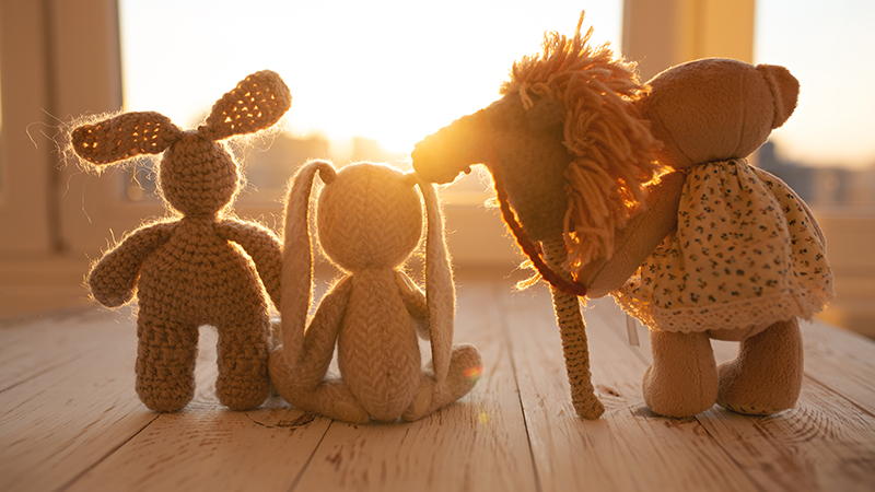 Stuffed animals in backlight