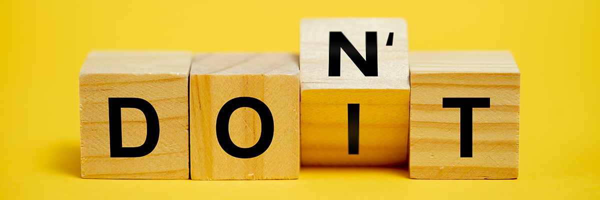 "Wooden blocks spelling ""DON'T"" and ""DO IT"""