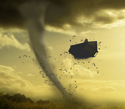 A house being swept away by a tornado
