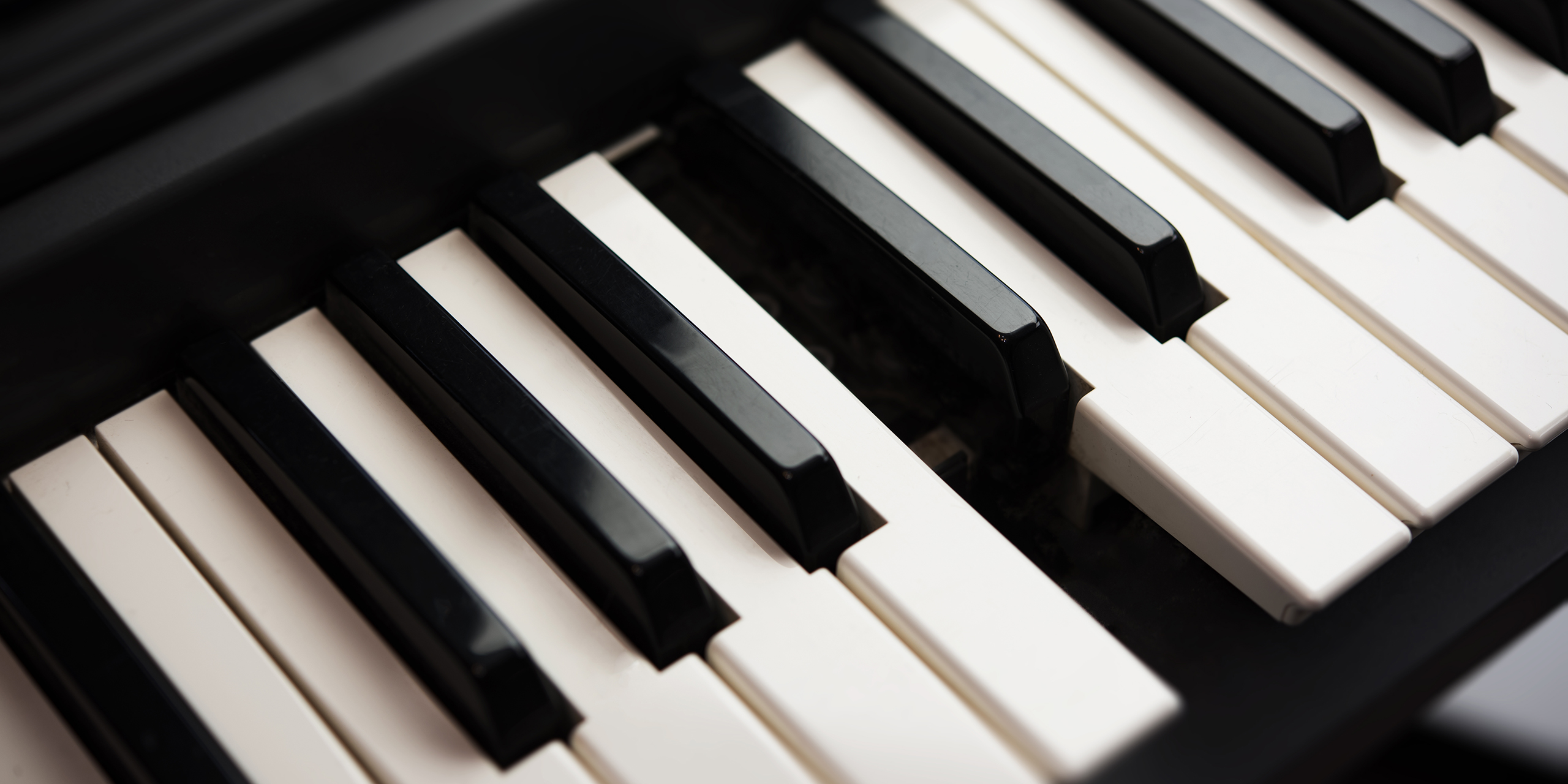 A piano missing a C key