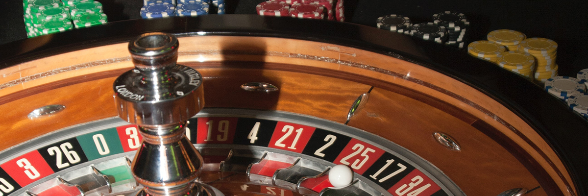 A roulette table surrounded by stacks of markers